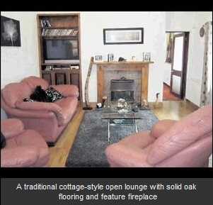 A traditional cottage-style open lounge with solid oak flooring and feature fireplace