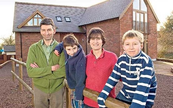 Eco fans: Mark and Lucy Edwards with their boys Jacob and Nathaniel, who built an eco house in the garden of their Georgian home